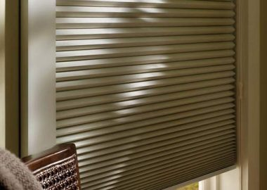 A close up of a window with cellular blinds fitted in it.