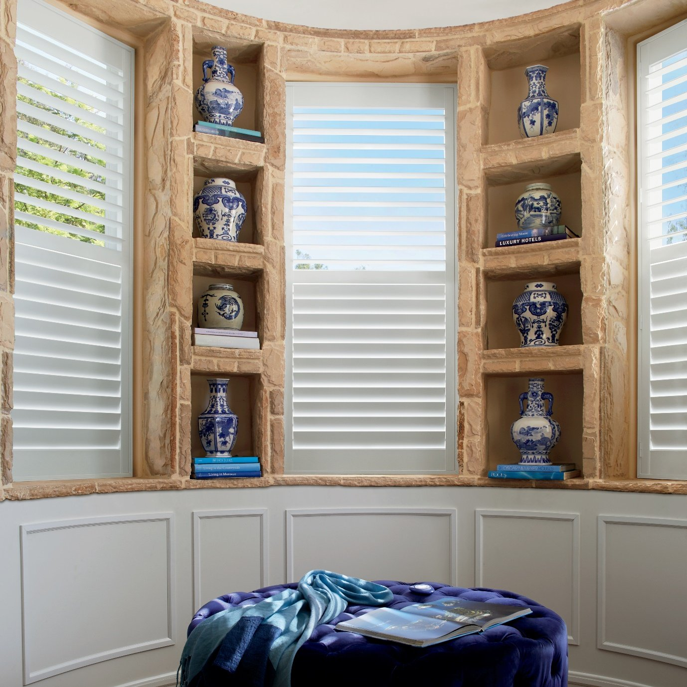 Bay window shutter with louvres.