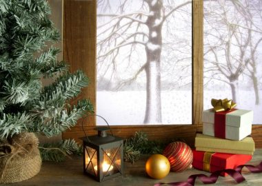 A windowsill with presents, ornaments, and candles
