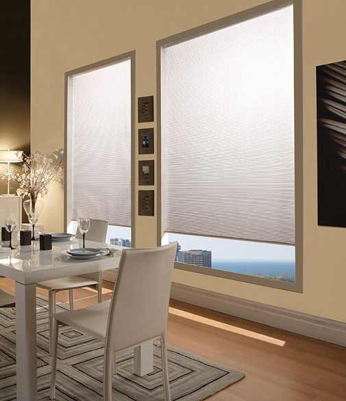 White pleated window shade in a dining room