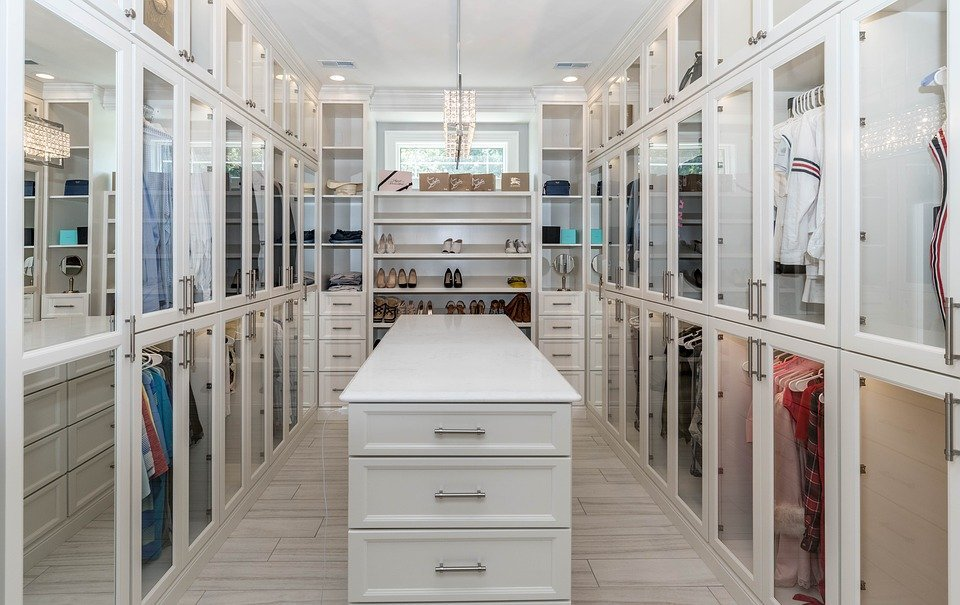 A custom-designed closet with a white theme