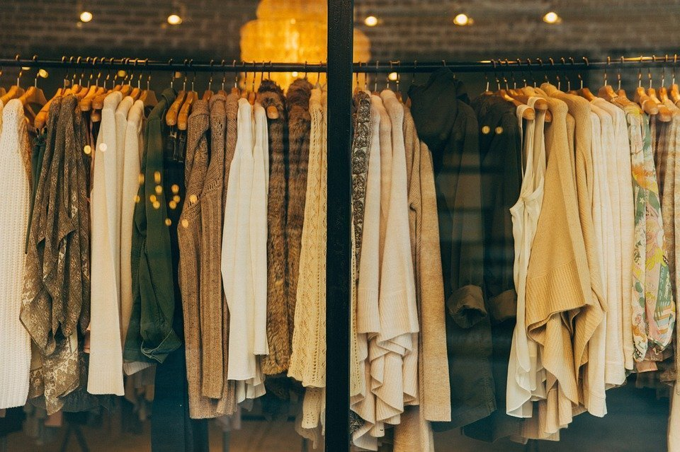 Racks of clothing colour-coordinated in a custom closet