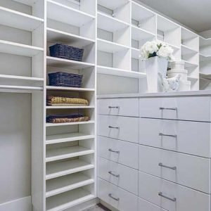 A neat and organized custom designed closet.