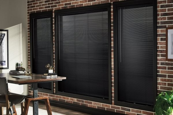 A black fully-covering solar screen shade.