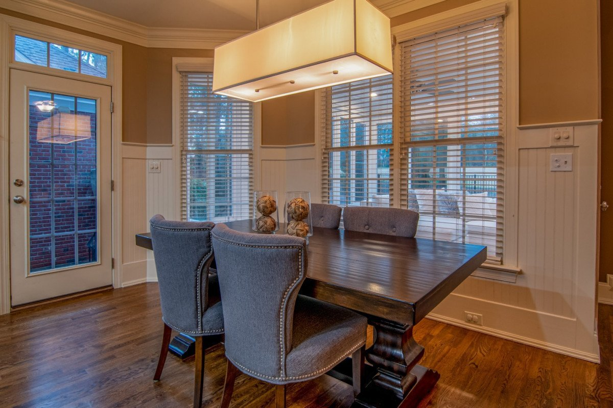 Wooden shutters in a living room helps you control natural light