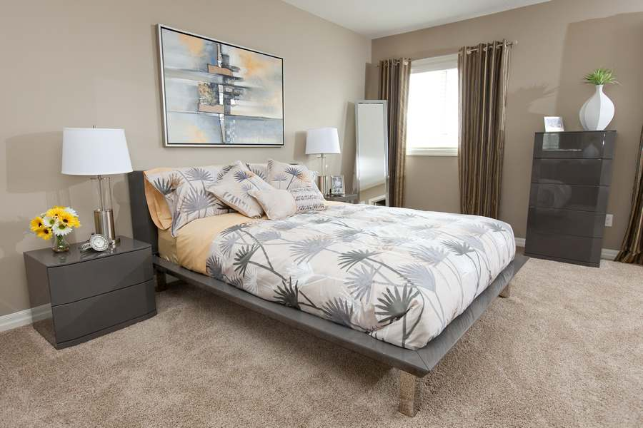 An elegantly designed bedroom with brown curtains
