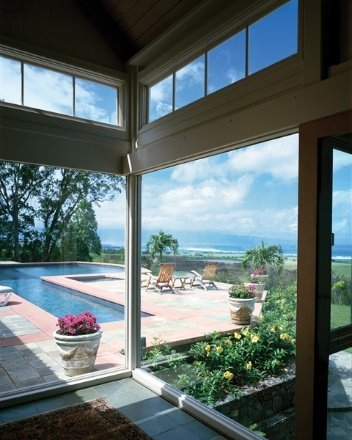 A large window covered with solar window film in a home