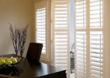 Vinyl shutters allowing the light to sink inside a room