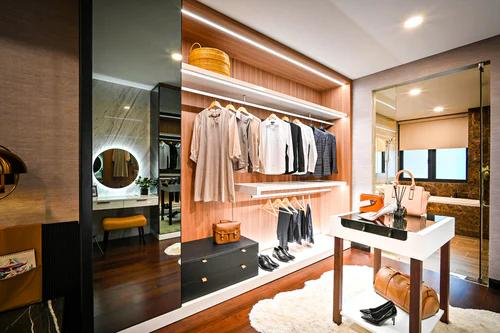 a wooden closet with clothes and shoes