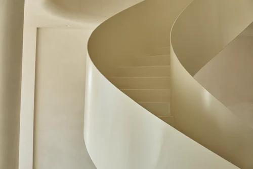 a minimalistic house with cream white stairs