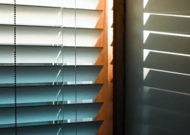 a close up of fauxwood blinds